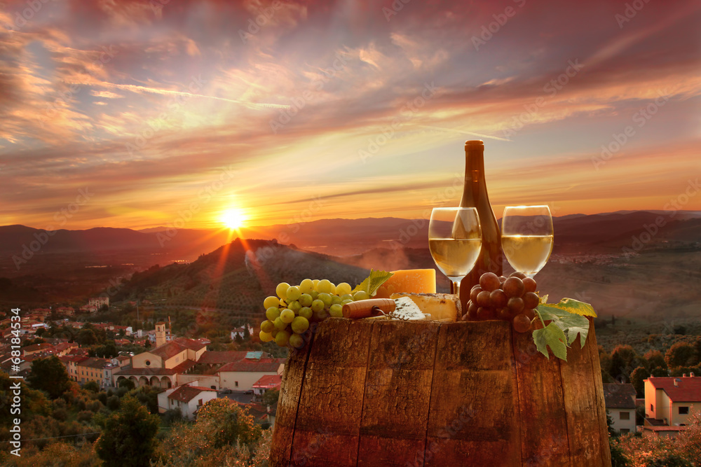 Fototapeta White wine with barell in vineyard, Chianti, Tuscany, Italy