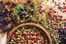 Peppercorn Mix In Wooden Bowl, Herbs And Spices