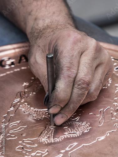 Making pattern on copper tray, Gaziantep, Turkey Poster