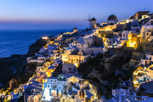 Typical View Of Houses And Buildings In Oia Village At Night