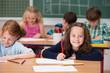 canvas print picture - kinder im unterricht in der grundschule