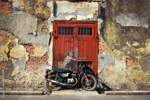 PENANG, MALAYSIA-JUL 18, 2014: General view of a mural 'Boy on a