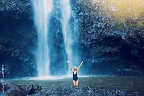 Fototapety, obrazy: Woman in pool at base of large watefall