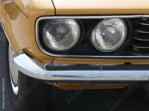 In de dag Vintage cars Doppelscheinwerfer eines Sportwagen Klassiker der Siebzigerjahre