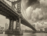 Cloudy evening in New York with Manhattan Bridge side view and c