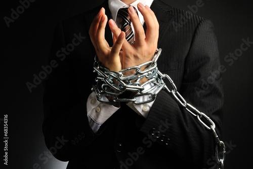 Fotografia  手を鎖で縛られたビジネスマン