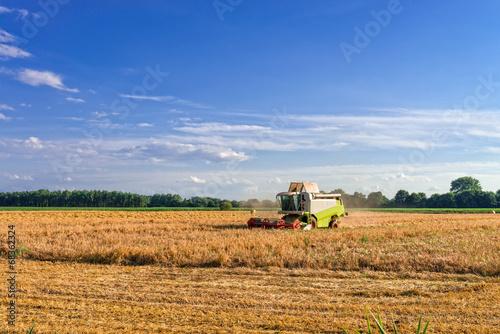 Foto auf Gartenposter Landschappen Tractors and harvesting