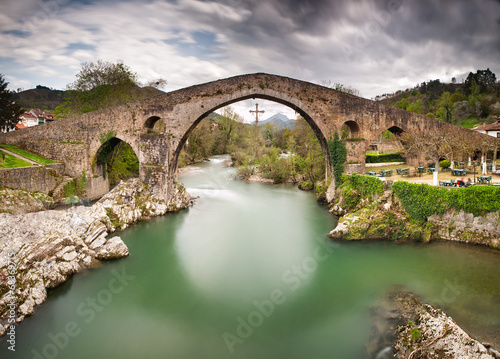 Old Roman stone bridge in Cangas de Onis (Asturias), Spain. Canvas Print