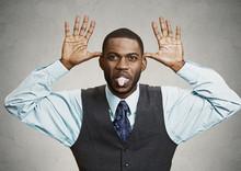 Executive Man Mocking Someone, Sticking His Tongue Out