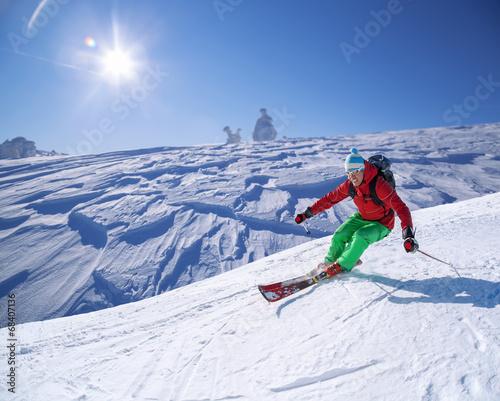 Tuinposter Wintersporten Skier against blue sky in high mountains