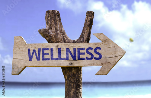 Fotografia  Wellness wooden sign on a beautiful day