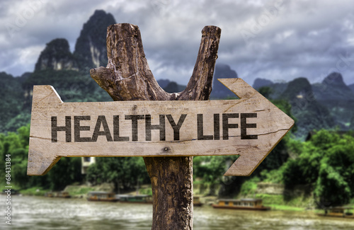 Photo  Healthy Life wooden sign with a forest background