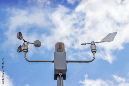 Photo Anemometer and wind vane on blue sky