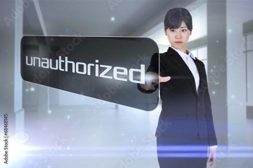 Fotografie, Obraz  Businesswoman pointing to word unauthorized