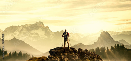 Photo Stands Mountaineering Hiker on Summit