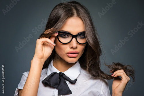 Beautiful sexy brunette young business woman wearing glasses