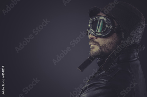 Canvas portrait pilot dressed in vintage style leather cap and goggles