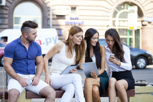 Canvas Prints Akt Business people sitting on a bench
