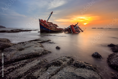 Photo Stands Shipwreck Fishing boat beached with sunset view