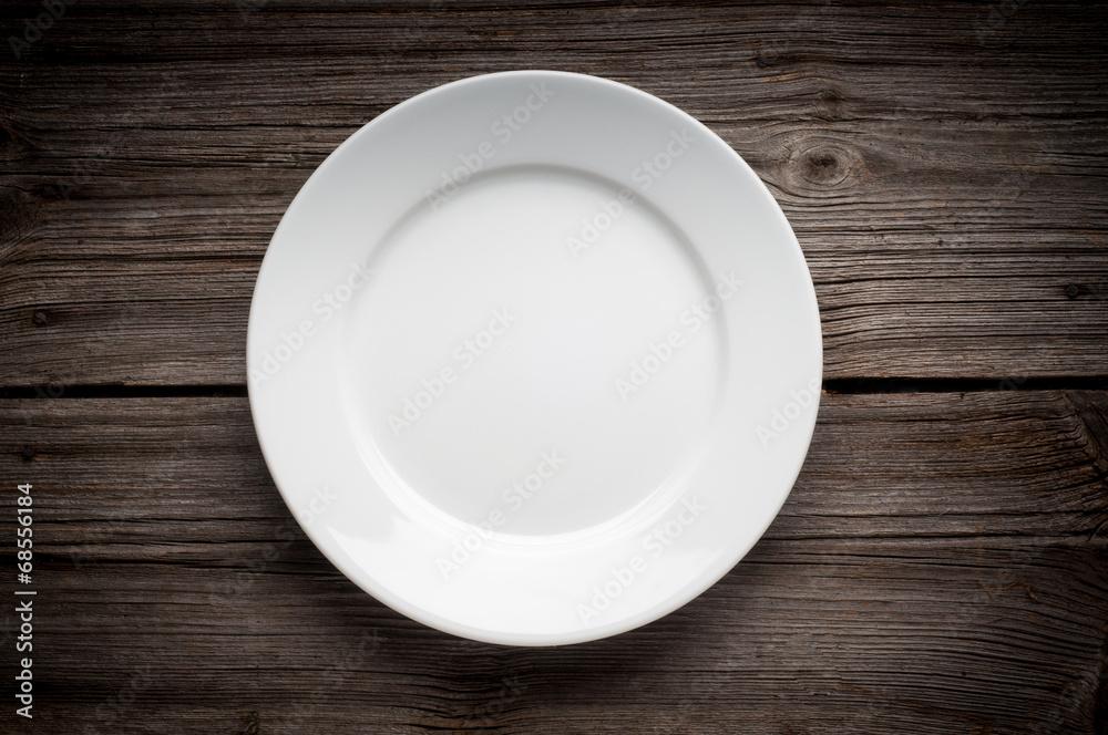 Fotografie, Obraz Empty white plate on wooden table