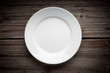 canvas print picture - Empty white plate on wooden table