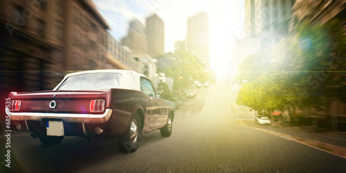 Fotografie, Obraz  Mušle auto na ulici