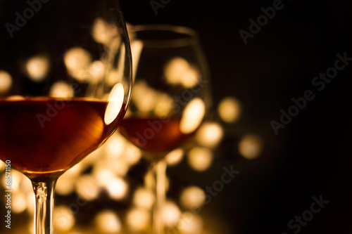 2 Red wine glasses. Christmas romantic dinner image.