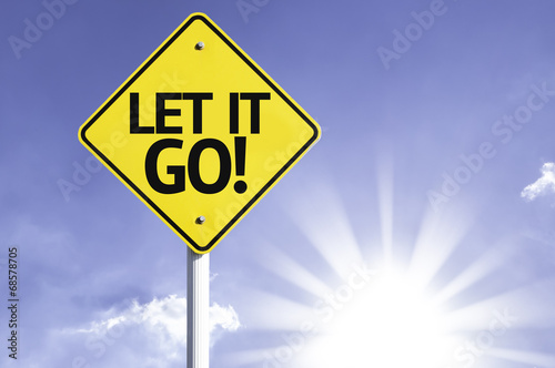 Photo  Let It Go road sign with sun background