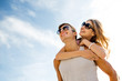 smiling couple having fun over sky background