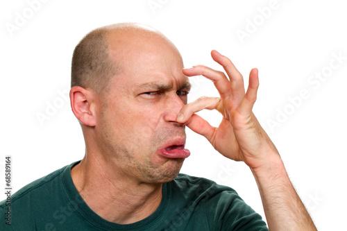 Obraz Man Holding Nose - fototapety do salonu