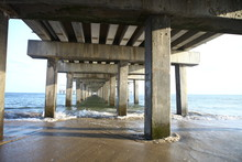 The Tunnel Under The Bridge Pier On The Ocean