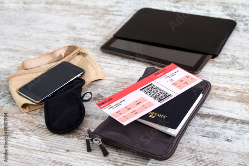 Fotografie, Obraz  Airline ticket, passport and electronics