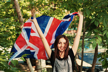 Brunette With Britain Flag In Her Hands Outdoors In Summer