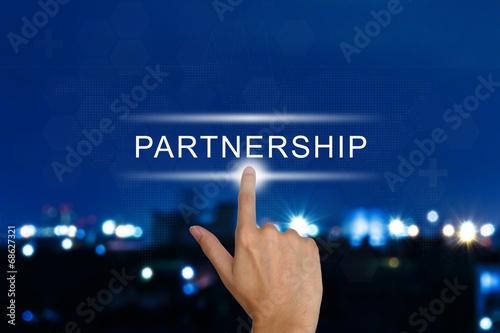 Fotografia  hand pushing partnership button on touch screen