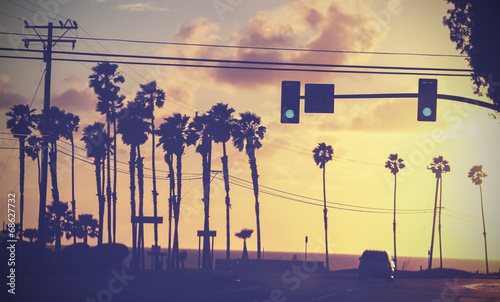 Tableau sur Toile Vintage toned picture of palms by a street at sunset, California, USA
