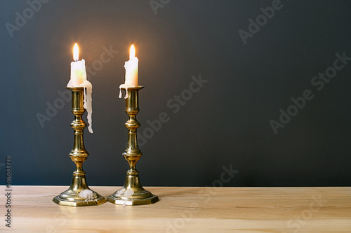 Photo Retro Candelabra With Burning Candles In Minimalist Room