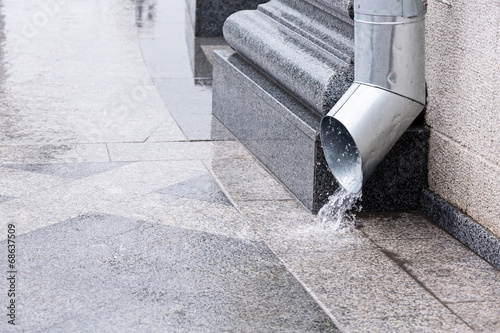 Photo  Water flow from drainpipe