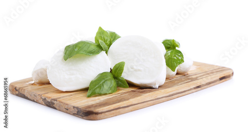 Fotografie, Obraz  Tasty mozzarella with basil on wooden board isolated on white