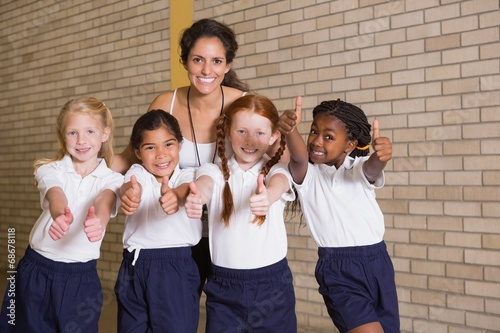 Fotografie, Obraz  Cute pupils smiling at camera in PE uniform
