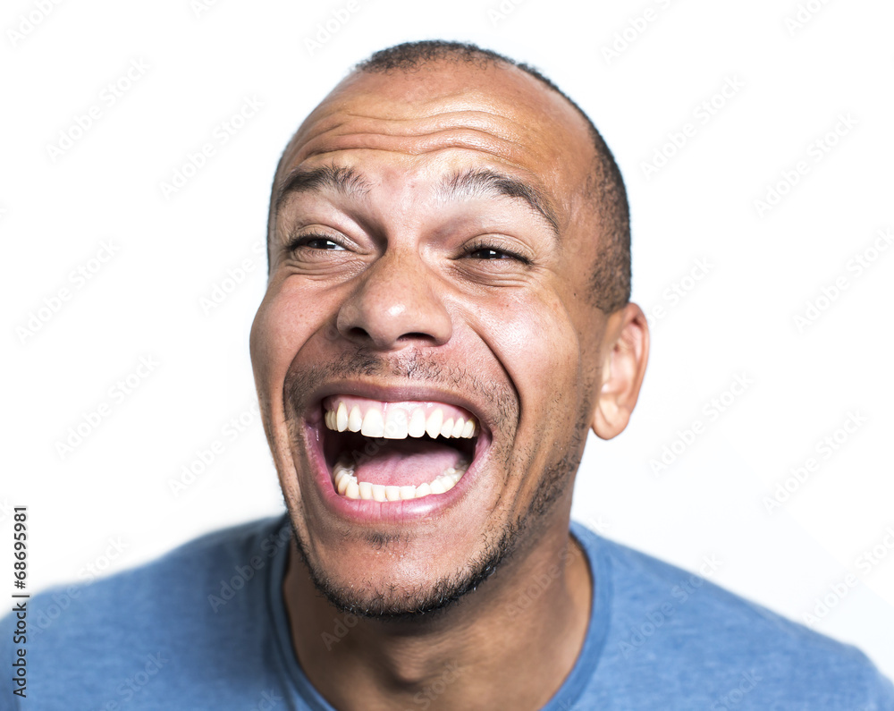 Fototapety, obrazy: Portrait of a mixed race man laughing hysterically