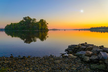 Sunrise And Morning Star On The Dnieper River In Kiev During Summer. Stones In The Foreground.