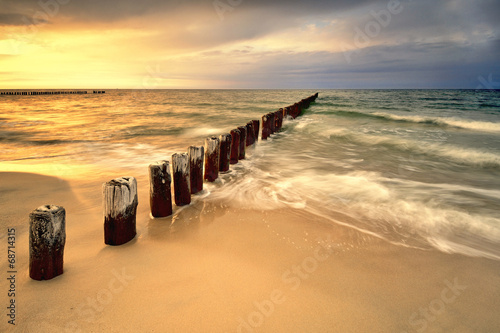 Fotobehang - Wschód słońca nad morzem