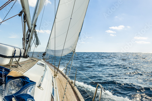 Slika na platnu Yacht sail in the Atlantic ocean at sunny day cruise