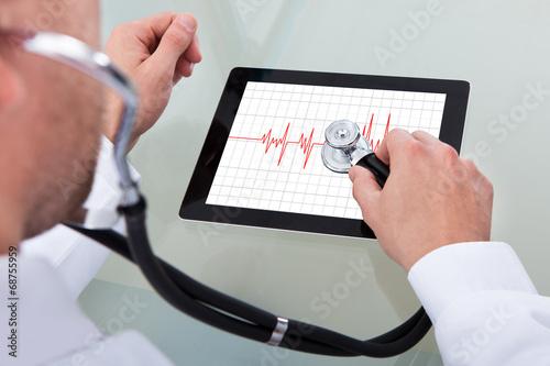 Fotografie, Obraz  Doctor Analyzing Heartbeat On Digital Tablet