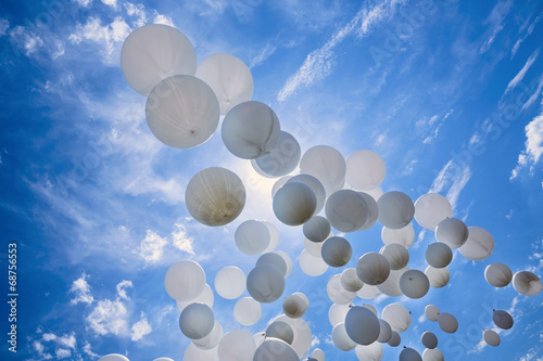 White balloons on the blue sky