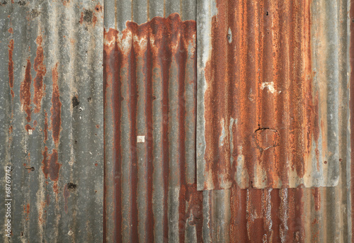 Foto  Rusty corrugated metal wall texture background