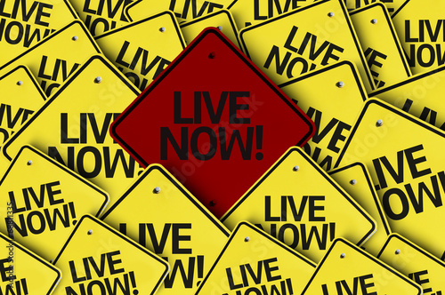 Fotografie, Obraz  Live Now! written on multiple road sign