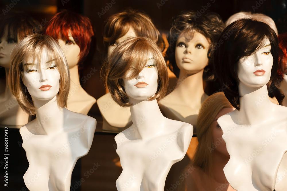 Fototapeta Mannikin heads in a wig store