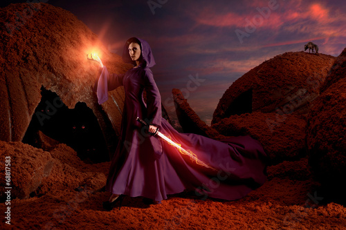 Beautiful sorceress in chocolate landscape