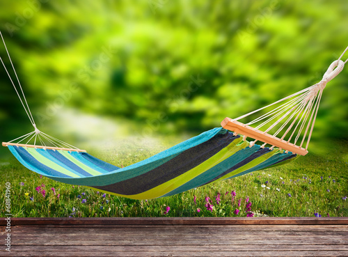 Relaxing on hammock in garden Canvas Print